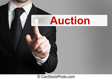 businessman pushing button auction - businessman in office...