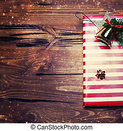 Christmas present with red color on dark wooden background...