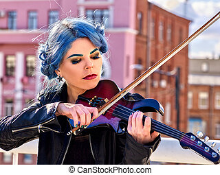 Woman playing violin alone - Woman performer playing violin...