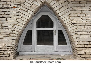 Triangle Arch In The Stone Wall With Door And Windows -...