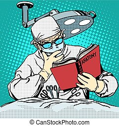 The surgeon before surgery is reading anatomy. Medicine and...