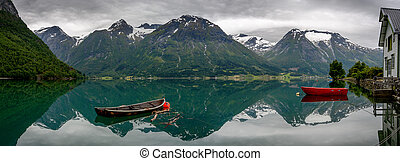 Boats and reflection in the water in panorama - Panorama of...