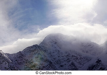 Mountains in clouds - Russia Caucasus View on Elbrus Mount -...
