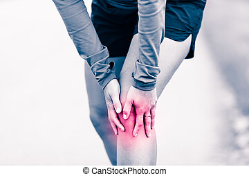 Knee pain, woman holding sore and painful leg - Runners knee...