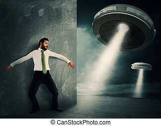 Frightened by UFO - Man hides frightened by UFO space...