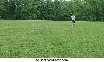 Soccer Goal Kick 02 - Soccer player kicks goal.