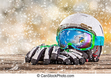 Colorful ski glasses, gloves and helmet