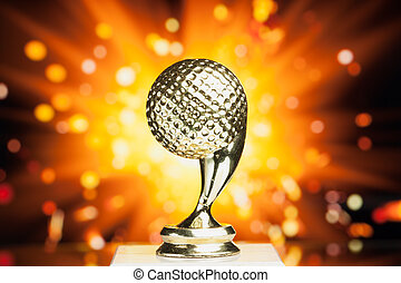 golf ball trophy against shiny sparks background