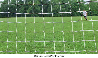 Soccer Goal Kick - Soccer player kicks goal