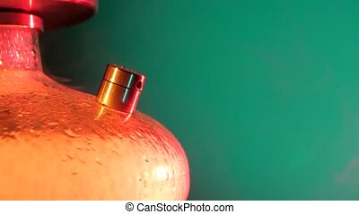 Colored orange hookah with the smoke, close up - Colored...
