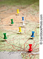 Travelling with pushpins - Colored pushpins on a road map of...