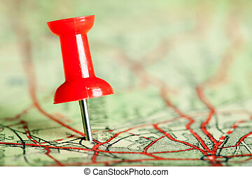 Pushpin on map - Red pushpin on a tourist map for travelling
