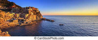 Manarola village panorama, rocks and sea at sunset Cinque...