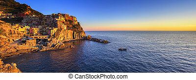 Manarola village panorama, rocks and sea at sunset. Cinque...