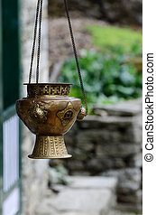 Old metal hanging incense-burner with swastika ornament ,...