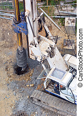 Hydraulic hammer drilling machine at construction site -...