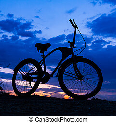 silhouette of bicycle on beautiful sunset
