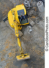 Excavator digger in construction site - Aerial view of...