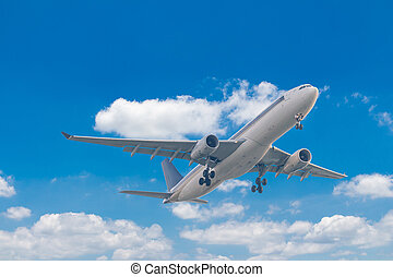 Commercial airplane flying with blue sky background