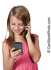 Little Girl Using Cell Phones - Beautiful little girl...