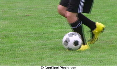 Soccer Player Dribbling 02 - Soccer player dribbling ball,...
