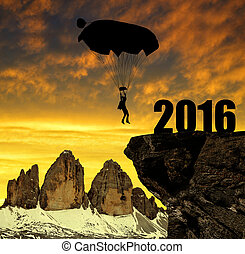Concept New Year 2016 - Silhouette skydiver parachutist...