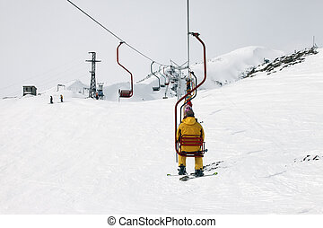 Ski lift - Peoples pooled up with ski lift. Cheget Mount....