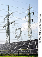 Green energy concept - Solar panels with electricity pylons...