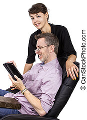 Daughter Giving Dad an E-Reader - Young female giving her...