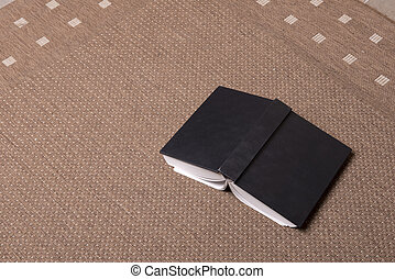 the book - a book thrown down on the carpet