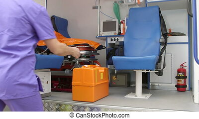 Emergency medical technician working at the site of illness...