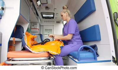 Emergency medical service female paramedic working at the...