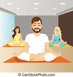 young people sitting in yoga pose on mat in gym in the...