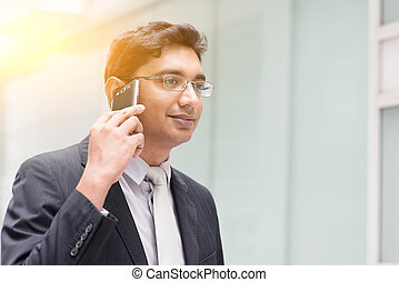 Asian Indian businessman on the phone - Portrait of Asian...