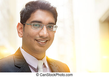 Asian Indian businessman smiling - Close up portrait of...