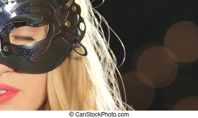 sexy blonde woman with venetian mask and glass of champagne,...