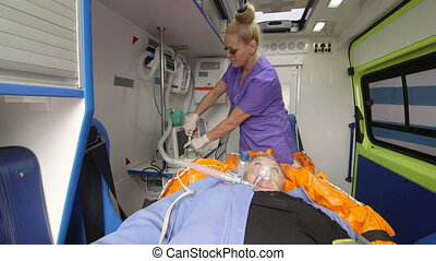 Paramedic provide emergency medical care to patient in...