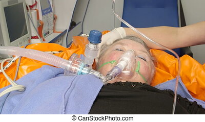 Senior female patient receiving advanced emergency medical...