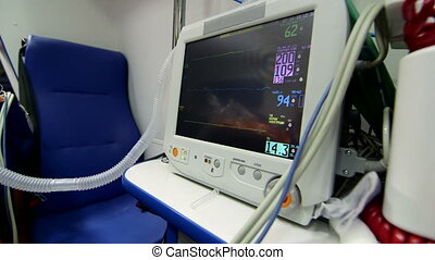 Medical equipment in ambulance patient monitor displayed...