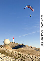 Paraglider moving away from the top of Mont Ventoux