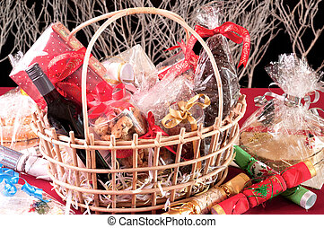 Christmas hamper basket with a chocolate santa, cookies and...