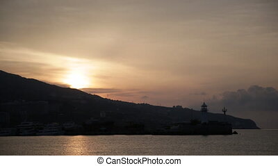 Beautiful sunrise over a beacon in Yalta, the Crimea