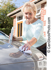 Senior Woman Polishing Car With Cloth