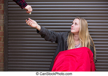 Teenage Girl Sleeping On The Street Being Given Money