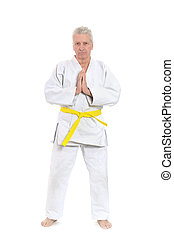 man in karate pose - Senior man in karate pose on white...