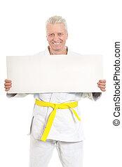 Karate Senior man with white poster on white background