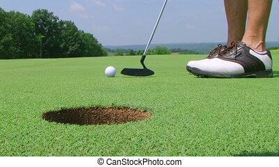 Golfer Sinks Putt 02 - Golfer sinks long putt, with shotgun...
