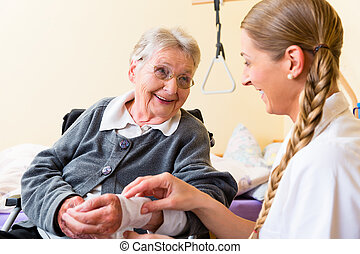 Nurse taking care of senior woman in retirement home...