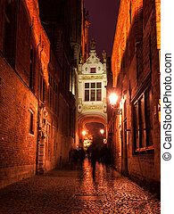 Blinde-Ezelstraat street in Bruges by night. - Bridge...