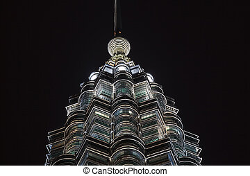 Top of Petronas Towers Silhouetted Against Night Sky - Round...